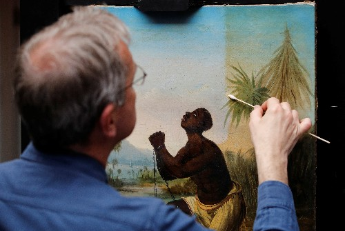 British conservationists work to restore acclaimed slavery painting
