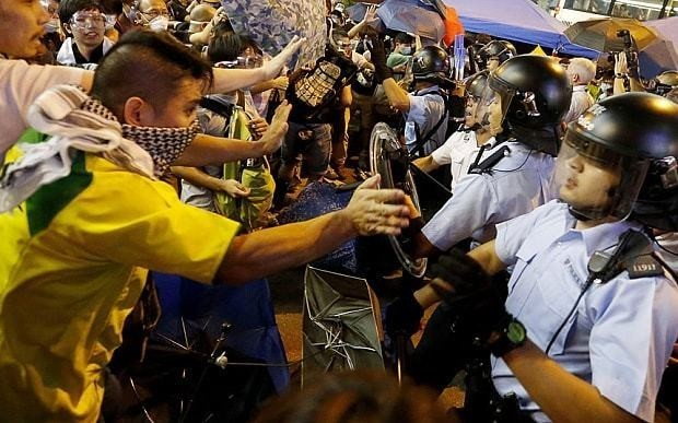 Hong Kong protesters attack 'despotic' leader after police raid