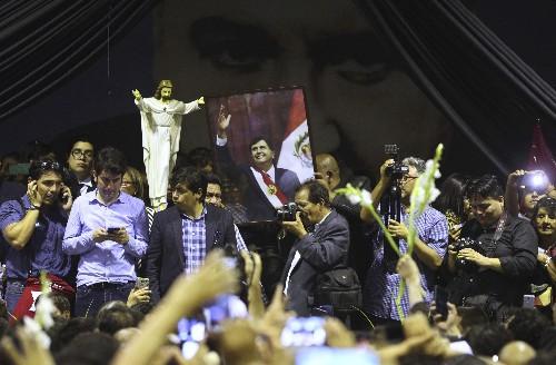 As police wait to arrest him, ex-Peru president kills self