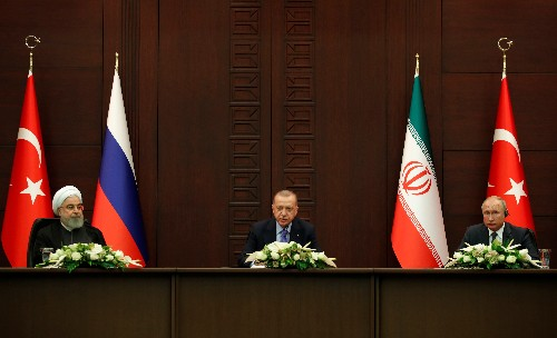 Iran says diplomacy only solution to Syria crisis at Turkey, Russia talks