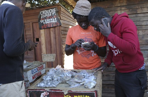 Desperate Zimbabweans use cell phone transfers to get cash