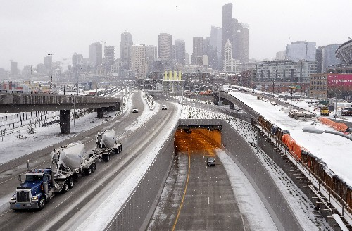 Rare snow falls on Seattle as Midwest thaws from cold blast
