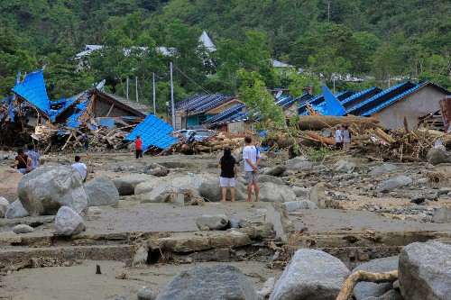 Indonesia's Papua set for mass burial as flood death toll tops 100