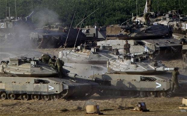 Rockets fired at Israeli nuclear plant as threat of invasion rises