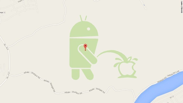 An Android robot is peeing on an Apple logo in Google Maps