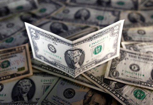 Dollar gains, but outlook suggests weak trend