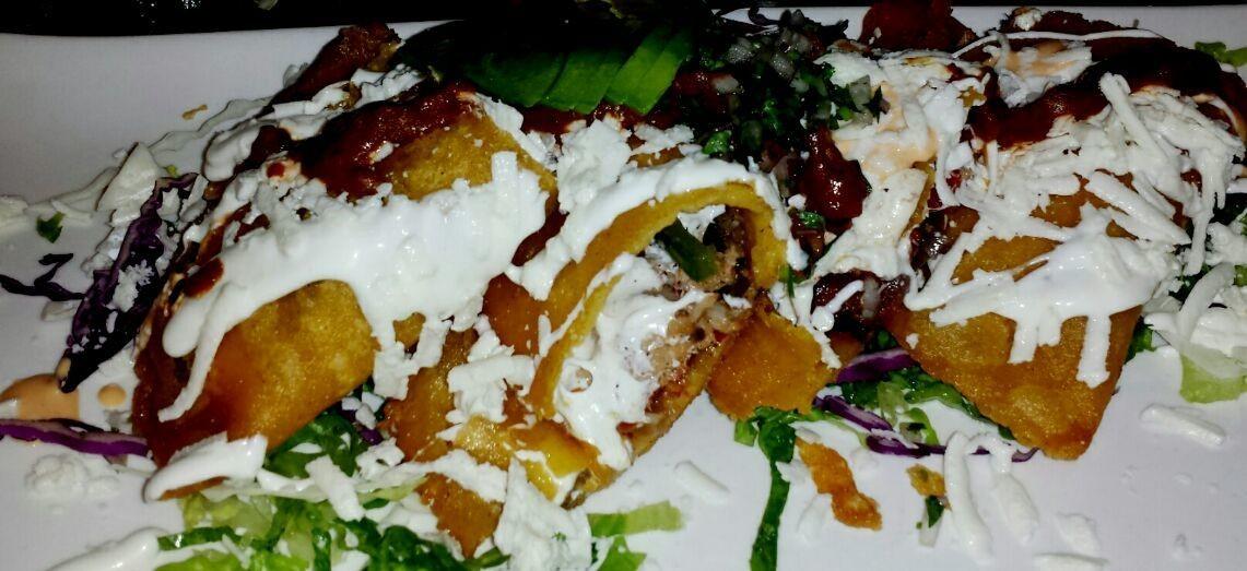 empanadas de camaron and oaxaca chesse toped with morita salsa.