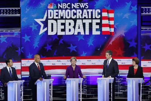 Democrats clash on healthcare, border in scrappy first U.S. presidential debate