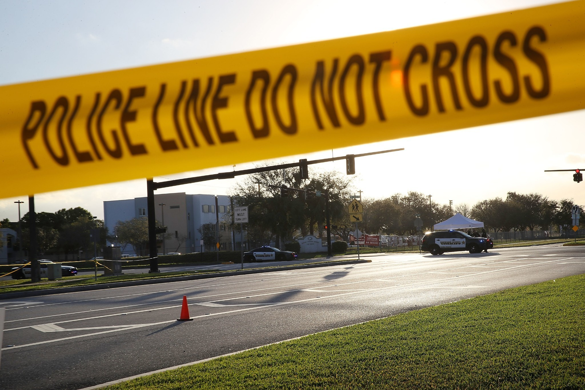 Multiple armed officers hung back during Florida school shooting, reports say