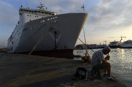 Greece: Strikes over labor changes halt ferries, services