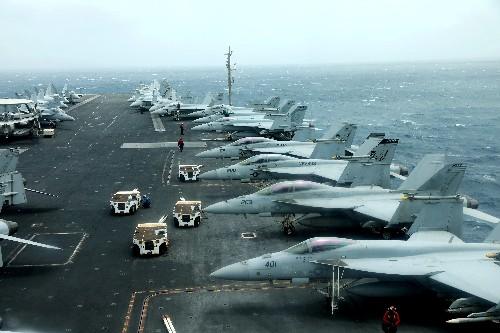 U.S. aircraft carrier strike group sails through Strait of Hormuz