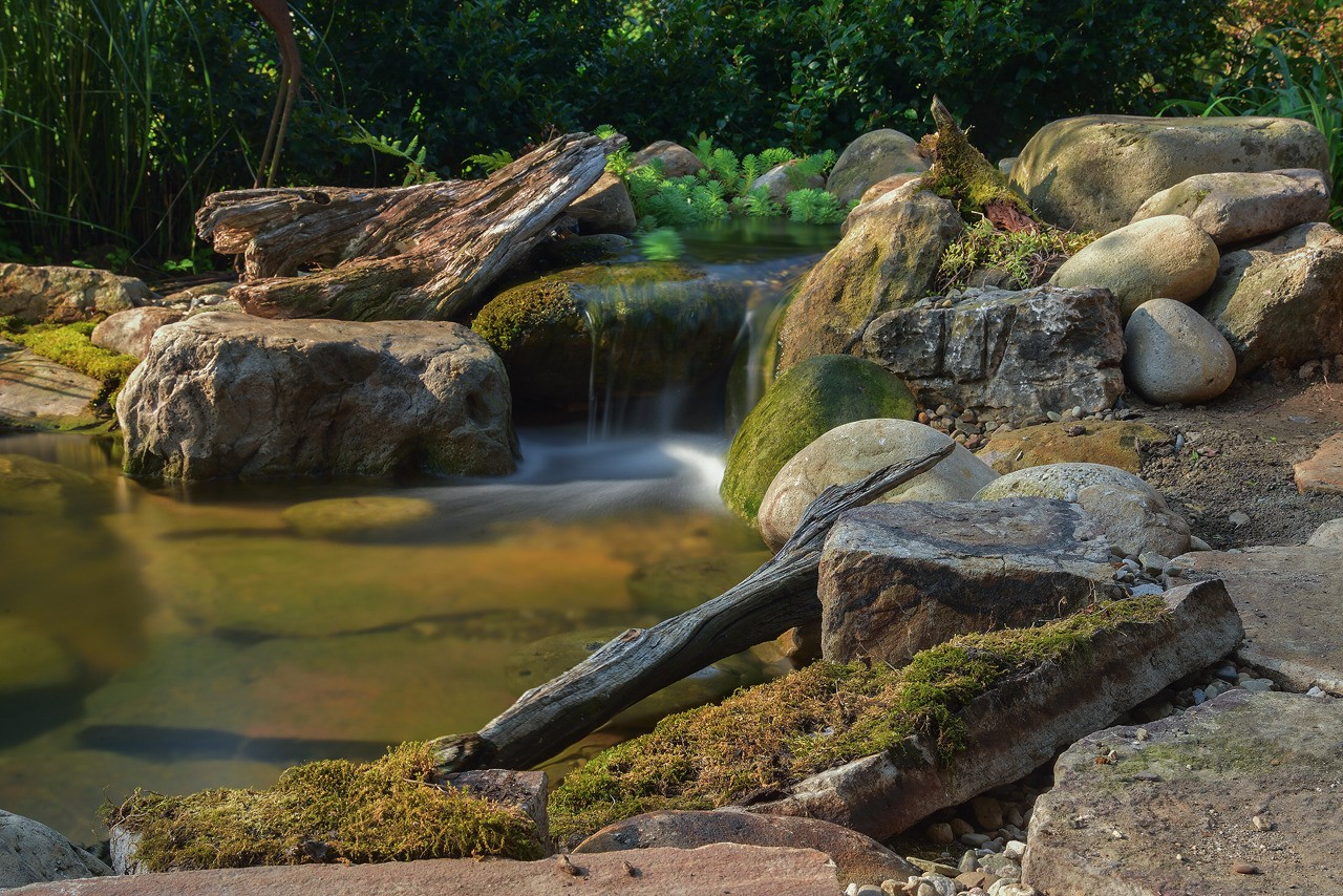 Nature-inspired waterfall and koi/goldfish pond built by Aquatic Edge in Greensburg PA.