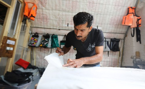Berlin project 'upcycles' refugee boats into bags