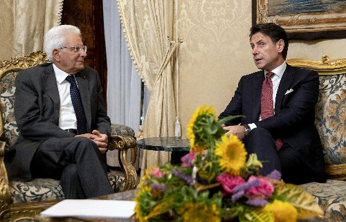 The Latest: Italian PM is asked to stay as caretaker leader