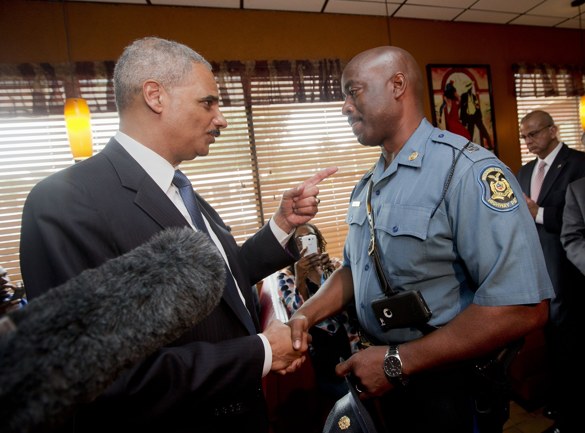 Holder says he understands mistrust of police