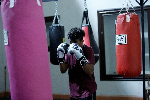 From prayer to boxing: Naples church offers jobless youths lifeline