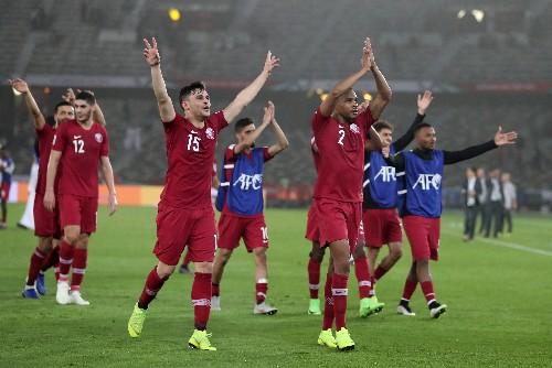 Soccer - Qatar put two past Saudi Arabia to finish top of Group E