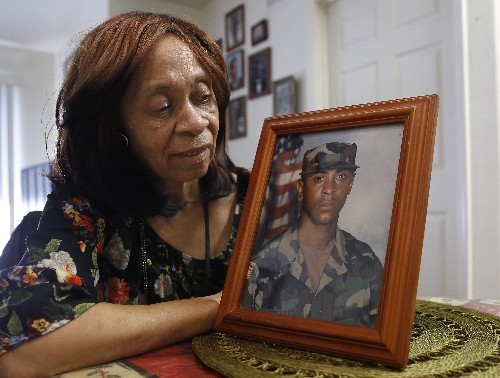 Veteran held on attempted murder counts after car hits crowd