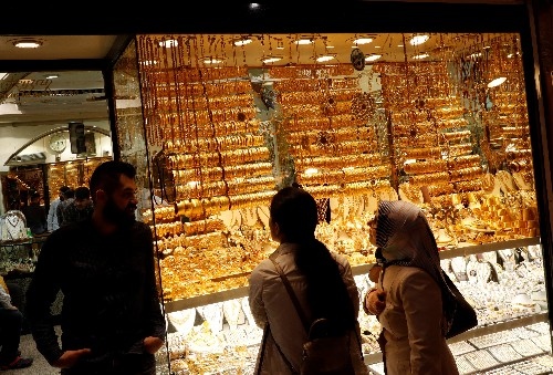 Gold rises to near six-year high on dollar weakness, U.S.-Iran tensions