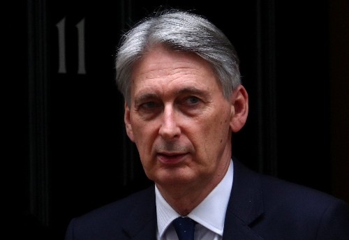 Britain must resolve Brexit but changing PM May wouldn't help, Hammond says