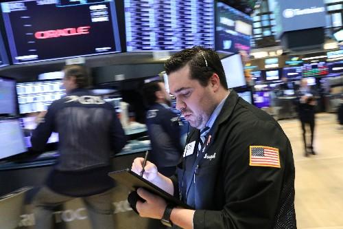 Wall Street finit irrégulière, 3M pèse sur le Dow