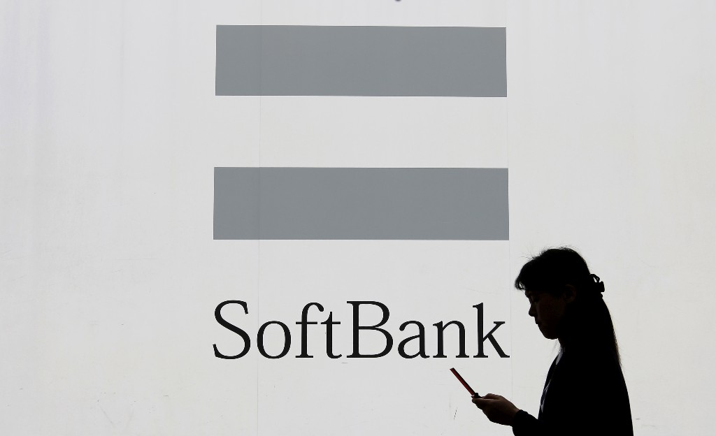 SoftBank drops operating profit measure as Son plays cash defence