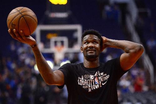 Booker scores 27 as Suns dispatch Warriors