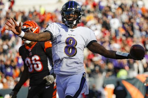 Jackson dazzles as Ravens rout winless Bengals 49-13