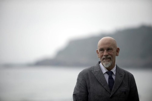 Actor Malkovich wins libel suit over Le Monde tax story