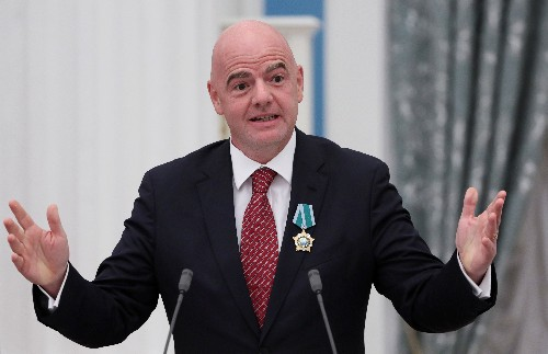 Putin honors FIFA's Infantino with state medal over 2018 World Cup