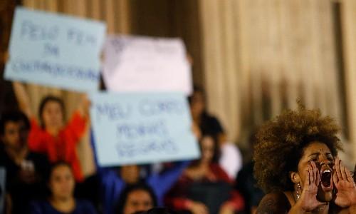 Rio de Janeiro police scour slums for suspects in girl's gang rape