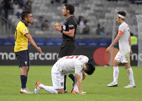 Soccer: Ecuador's draw with Japan send Paraguay into quarters