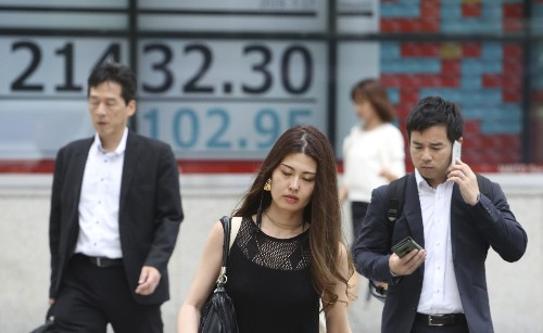 Global stocks mostly fall as Wall Street ends winning streak