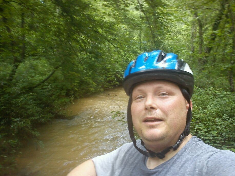 Me at a stream in the woods.