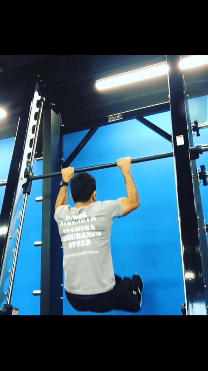 Hanging L-sit holds into pull overs and negative muscle ups . 3 sets of 5 reps will help build strength for muscle ups and increase hold time for L- sit holds . Core stability is the key here and strength is the base !!