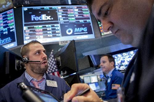 FedEx cuts profit forecast again on economy, Express woes
