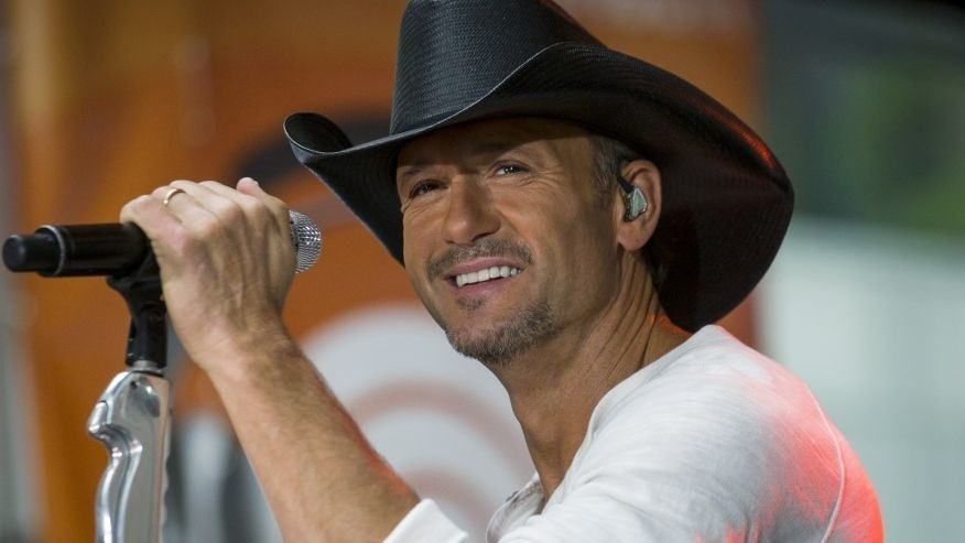 Tim McGraw 'swatted' fan during show, rep says
