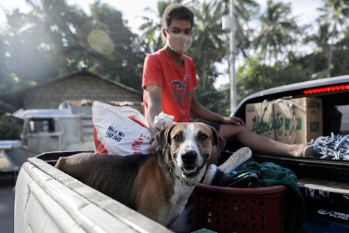 Philippine residents retrieve animals, belongings amid threat of volcano eruption
