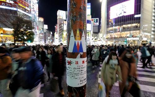 Japan artist says latest sticker graffiti aimed at Trump