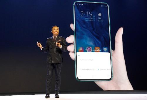 EE keeps Huawei in first British 5G network but halts handsets