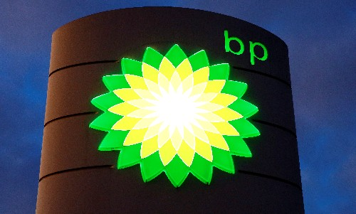 BP's profit slump buffered by higher output, trading
