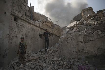 The Latest: US-led coalition says Iraqis have retaken Mosul