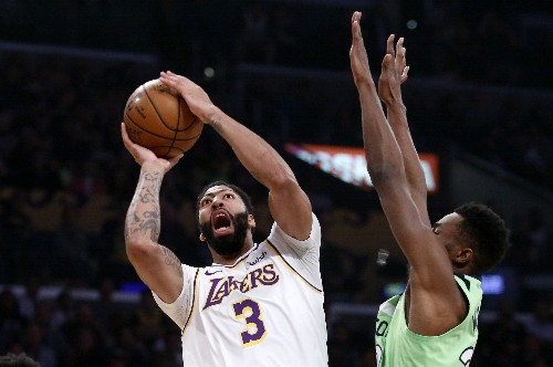 Davis scores 50, powers Lakers to 142-125 win over T-Wolves