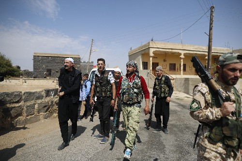 In Syria's Sweida, young men take up arms to defend villages