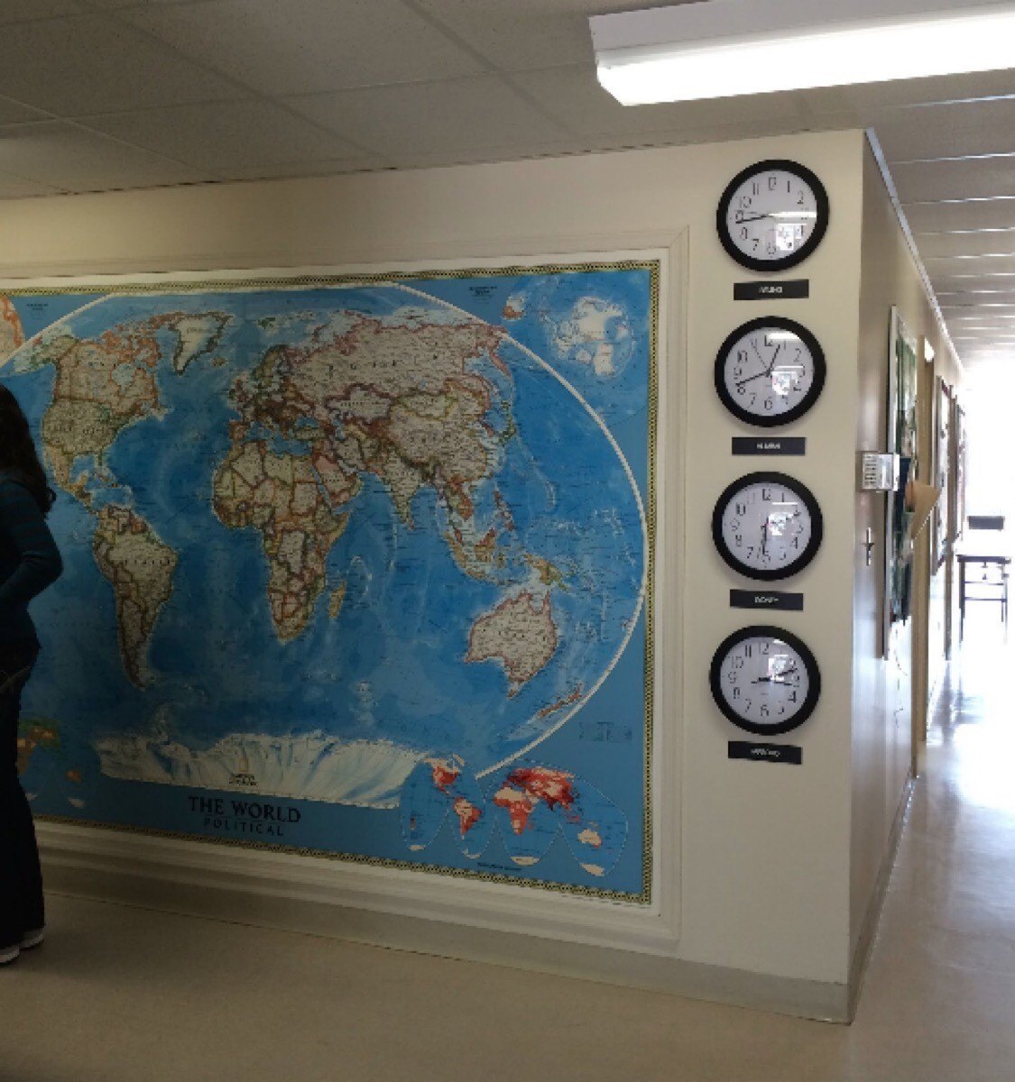 Adding clocks with different times get the conversation started with students. Lots of maps make a statement...