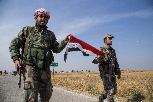 Kurds say pullout from Syrian border region complete