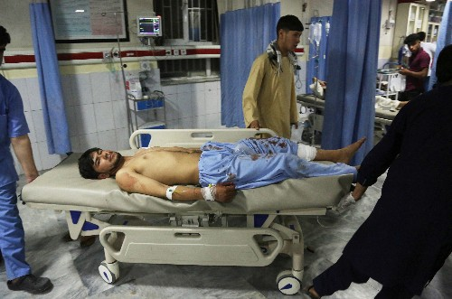 The Latest: Witness says children killed in Kabul blast