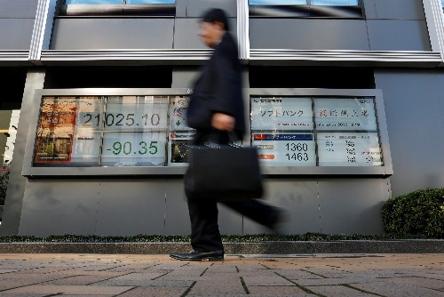 Cash-hoarding Japanese firms please investors as share buybacks hit record