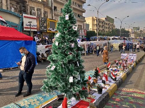 Baghdad mob kills teen gunman and strings up his corpse