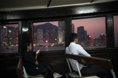 In protest clouds, Hong Kong tourists see silver lining